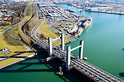 Nederland, Zuid-Holland, Rotterdam, 18-02-2015. Rozenburg, Calandkanaal en Thomassentunnel gezien naar Brittaniehaven.<br /> Caland Canal and tunnel, Britany harbour.<br /> luchtfoto (toeslag op standard tarieven);<br /> aerial photo (additional fee required);<br /> copyright foto/photo Siebe Swart