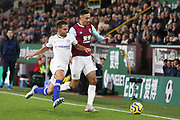 Chelsea defender C?sar Azpilicueta (28) and Burnley midfielder Dwight McNeil (11) during the Premier League match between Burnley and Chelsea at Turf Moor, Burnley, England on 26 October 2019.
