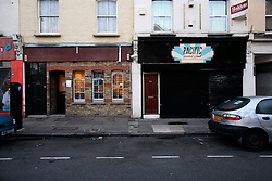 UK ENGLAND LONDON 19AUG11 - General view of the R & B and Pacific Social Club cafes in Clarence Road, Hackney, east London. During the August riots in London, Clarence Road in Hackney featured some of the most devastating scenes of looting and violence...jre/Photo by Jiri Rezac..© Jiri Rezac 2011