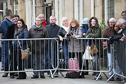 © Licensed to London News Pictures . 18/03/2016 . Manchester , UK . Members of the public gather to watch as the coffin enters the church before the service. . Television stars and members of the public attend the funeral of Coronation Street creator Tony Warren at Manchester Cathedral . Photo credit : Joel Goodman/LNP