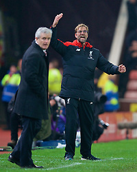 STOKE-ON-TRENT, ENGLAND - Tuesday, January 5, 2016: Liverpool's manager Jürgen Klopp and Stoke City's manager Mark Hughes during the Football League Cup Semi-Final 1st Leg match at the Britannia Stadium. (Pic by David Rawcliffe/Propaganda)