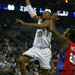 15 April 2008: New Orleans Hornets forward David West #30 drives and shoots over Josh Powell #21 of the Los Angeles Clippers in the second quarter of the Hornets 114-92 win over the Clippers at the New Orleans Arena in New Orleans, Louisiana.