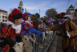 November 18, 2018 - Amsterdam, Netherlands - The Zwarte Piet, the helpers of St. Nicholas, distribute sweets to the children in attendance. Amsterdam, The Netherlands.  November 18, 2018. After his arrival in Zaandam yesterday Friday, today it is Amsterdam who receives St. Nicholas. Many attendees receive the saint from Spain on a quieter day in which none of the anti-racist groups who received him yesterday in a protest in which it was requested that the character Zwarte Piet not wear the face painted black. An issue that is creating quite a lot of controversy throughout the country  (Credit Image: © Nacho Calonge/NurPhoto via ZUMA Press)