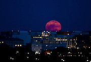 """A perigee moon rises over Washington, D.C. shortly after sunset on Saturday night. The perigee moon appears so large because it is at the """"perigee"""" point in its orbit around earth, the closest point in the orbit's ellipse. """"The full Moon of March 19th occurs less than one hour away from perigee,"""" says Geoff Chester of the U.S. Naval Observatory  """"a near-perfect coincidence that happens only every 18 years or so."""""""