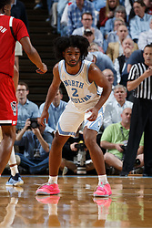 CHAPEL HILL, NC - FEBRUARY 05: Coby White #2 of the North Carolina Tar Heels defends during a game against the North Carolina State Wolfpack on February 05, 2019 at the Dean Smith Center in Chapel Hill, North Carolina. North Carolina won 113-96. North Carolina wore retro uniforms to honor the 50th anniversary of the 1967-69 team. (Photo by Peyton Williams/UNC/Getty Images) *** Local Caption *** Coby White