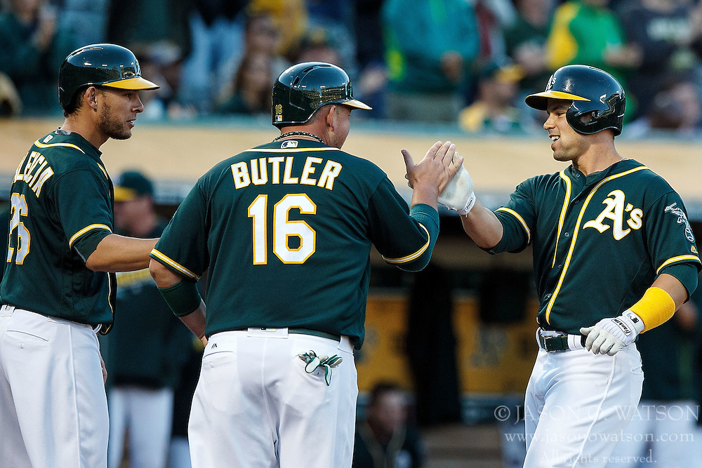 OAKLAND, CA - JULY 21:  Jake Smolinski #5 of the Oakland Athletics is congratulated by Billy Butler #16 and Danny Valencia #26 after hitting a three run home run against the Tampa Bay Rays during the second inning at the Oakland Coliseum on July 21, 2016 in Oakland, California. (Photo by Jason O. Watson/Getty Images) *** Local Caption *** Jake Smolinski; Billy Butler; Danny Valencia