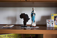 CASERTA, ITALY - 25 FEBRUARY 2015: Miniatures of the African continent and of the Holy Mary are here in Sister Rita Giaretta's office at Casa Rut, a shelter for abused young immigrant women in Caserta, Italy, on February 25th 2015.<br /> <br /> Casa Rut was founded in 1995 and it is promoted and managed by the Ursuline Sisters of the Sacred Heart of Mary of Breganze (Vicenza, Italy).  Casa Rut's goal is to provide young immigrant women a familiar environment where  they are helped to protect and free themselves, and to undertake a common path aiming to the integration in Italy's society.