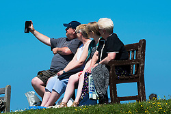 © London News Pictures. 02/06/2016. Aberystwyth, UK. On the second day of meteorological summer, people enjoy an afternoon of clear blue skies and warm sunny weather in Aberystwyth on the Cardigan Bay coast of West Wales. In contrast to the overcast and damp conditions in the east of the country. Photo credit: Keith Morris/LNP