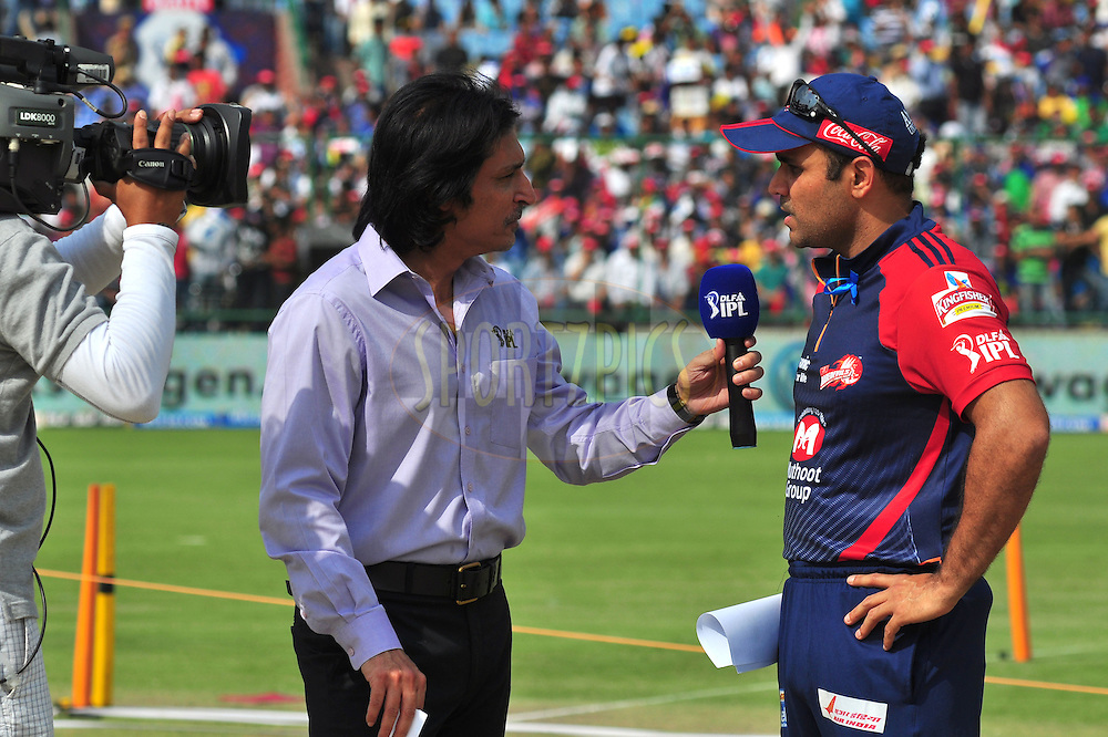 Delhi Daredevils captian Virender Sehwag with commontator Rameez Raja  during toss match 39 of the the Indian Premier League ( IPL) 2012  between The Delhi Daredevils and the Rajasthan Royals held at the Feroz Shah Kotla, Delhi on the 29th April 2012..Photo by Arjun Panwar/IPL/SPORTZPICS