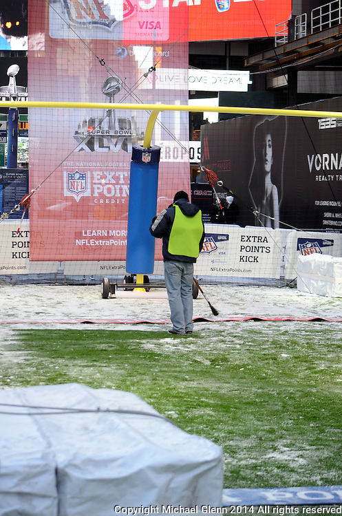 29 Jan 2014 NYC  Extra point display gets the snow swept off the floor in preperation for Superbowl boulevard //  Michael Glenn