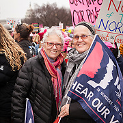 "Rene C., left and Maura P., traveled from Massachusetts to attend the Women's March on Washington to ""march for their daughters and granddaughters"" where an anticipated 200,000 people turned into an estimated 500,000 to 1 million people, on Saturday, January 21, 2017.  When asked about their hopes for the next 4 years, Maura responded, ""...that everybody speaks out...that the majority rules...""  To which Rene added, ""...hoping Trump's election will coalesce the people...to push back against his policies...""  John Boal Photography"