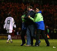 Photo: Jed Wee.<br /> Middlesbrough v FC Basle. UEFA Cup. Quarter-Final. 06/04/2006.<br /> <br /> Stewards restrain a pitch invader.