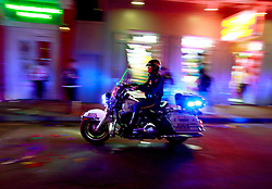 03 Feb 2013. New Orleans, Louisiana USA. .Bourbon Street. A police motorcycle races through the heart of the French Quarter..Photo; Charlie Varley