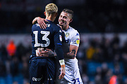 Kalvin Phillips of Leeds United (23) hugs Will Huffer of Leeds United (13) with a big smile on his face after the EFL Sky Bet Championship match between Leeds United and Bristol City at Elland Road, Leeds, England on 24 November 2018.