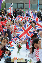 ©  licensed to London News Pictures. .Gravesend UK.28/04/2011.Kent school children parade through Gravesend Town Centre and then enjoy a street party outside Woodville Halls, Gravesend.  600 school children took part in this event today to mark the Royal Wedding of Kate Middleton and Prince William..Please see special instructions..Picture credit should read Grant Falvey/LNP......