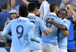 Sporting Kansas City midfielder Jimmy Medranda hugs midfielder Valeri Quzaishvili after Quzaishvili scored in the first half against the San Jose Earthquakes during the U.S. Open Cup semifinals at Children's Mercy Park in Kansas City, Kan., on Wednesday, Aug. 9, 2017. (Photo by John Sleezer/Kansas City Star/TNS/Sipa USA) *** Please Use Credit from Credit Field ***