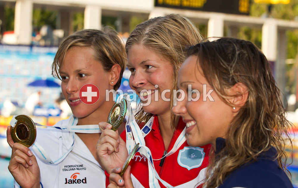 (L-R) Third placed Federica PELLEGRINI of Italy, winner Lotte FRIIS of Denmark and Ophelie Cyriell ETIENNE of France pose with their medals after competing in the women's 800m Freestyle Final at the European Swimming Championship at the Hajos Alfred Swimming complex in Budapest, Hungary, Thursday, Aug. 12, 2010. (Photo by Patrick B. Kraemer / MAGICPBK)