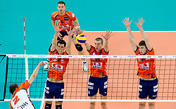 Lukas Divis of Jastrzebski vs Alen Sket, Milan Rasic and Uros Kovvacevic of Ach during volleyball match between ACH Volley (SLO) and Jastrzebski Wegiel (POL) in 6th Round of 2011 CEV Champions League, on January 12, 2011 in Arena Stozice, Ljubljana, Slovenia. (Photo By Vid Ponikvar / Sportida.com)