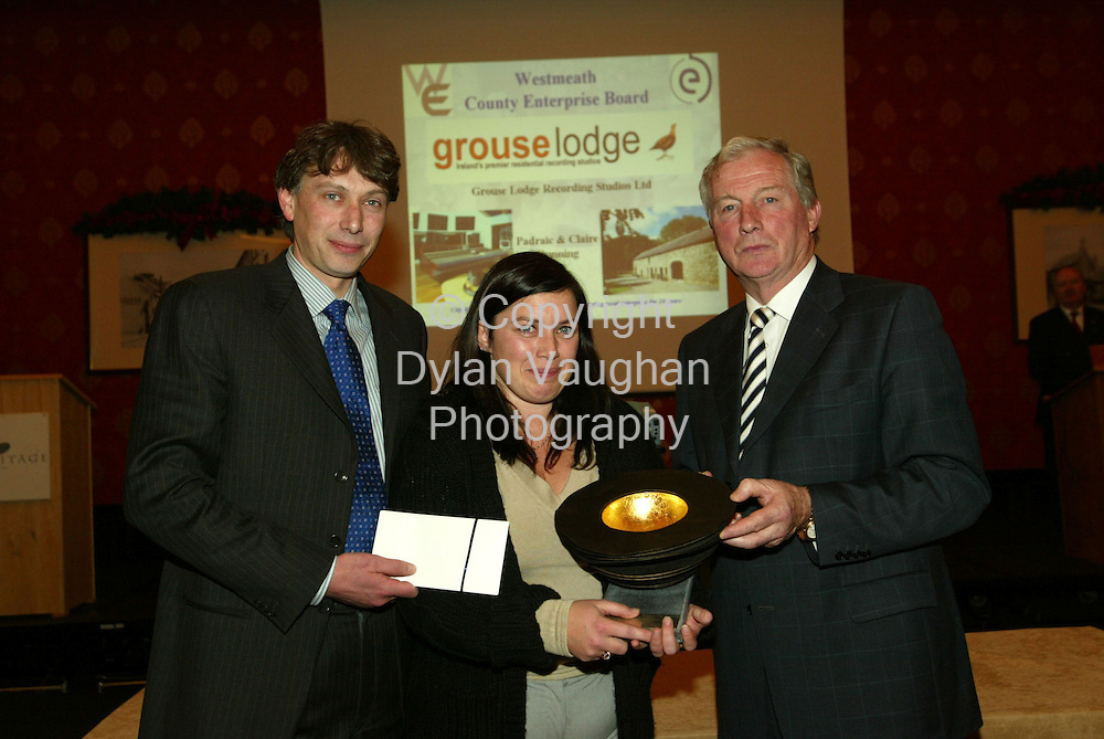 27/11/2003.Free picture no charge.Pictured at the Heritage Hotel, PortLaoise were from left Padraig and Claire Dunning of Grouse Lodge Recording Studios, Rosemount Moate, winners of the overall National Enterprise Award 2003 with the Minister for Defence Mr Michael Smith TD.The 35 city and county Enterprise Boards throughout the country yesterday celebrated 10 years in business and the creation of 30,000 jobs..Picture Dylan Vaughan