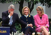 US President Bill Clinton jokes with first lady Hillary Clinton and Tipper Gore during an event at the White House March 22, 1997 in Washington, DC.