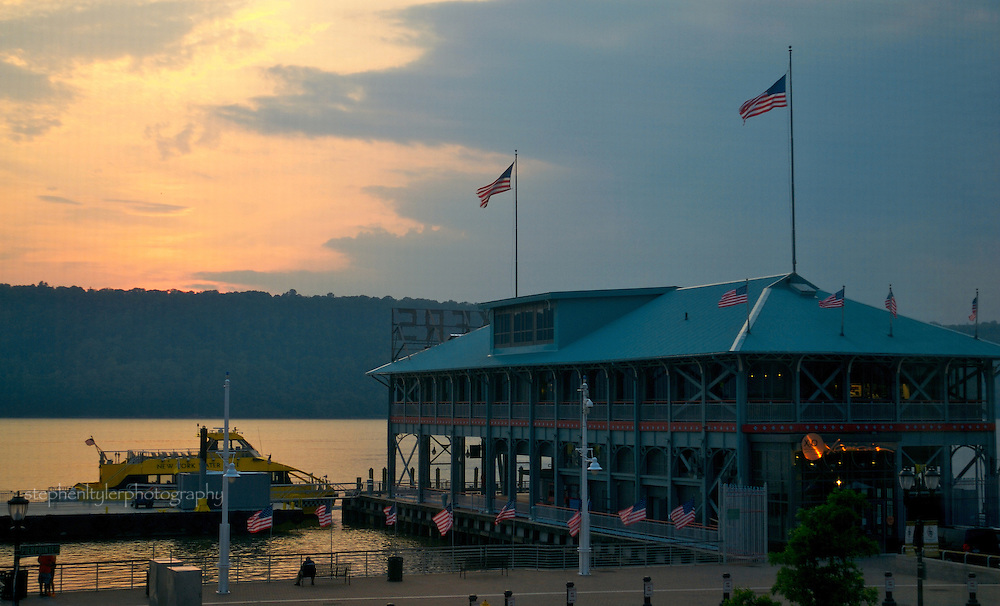 New York water taxi after last run; parked at the Yonkers Pier at end of the day, dusk.