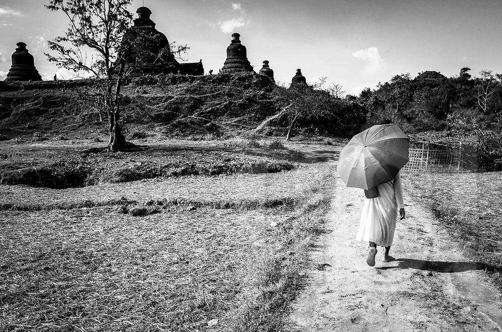 Monk visits temple vestiges in Mrauk U, Rakhine State, Myanmar, Asia