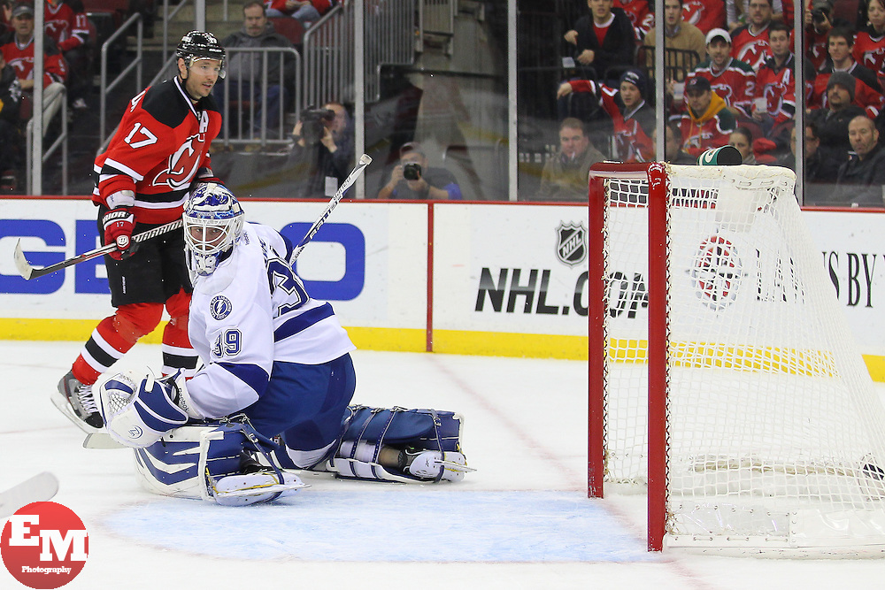 Feb 7, 2013; Newark, NJ, USA; New Jersey Devils right wing Ilya Kovalchuk (17) scores a goal on Tampa Bay Lightning goalie Anders Lindback (39) during the second period at the Prudential Center.