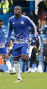 Chelsea defender Kurt Zouma warming up before the Barclays Premier League match between Chelsea and Everton at Stamford Bridge, London, England on 16 January 2016. Photo by Andy Walter.