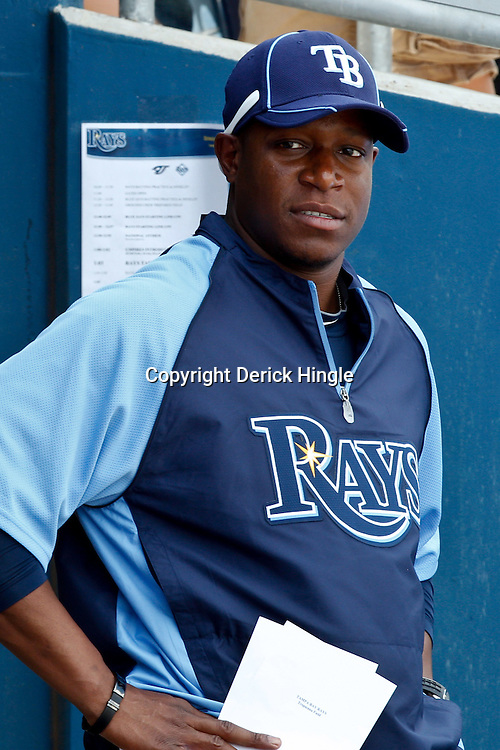 March 8, 2011; Port Charlotte, FL, USA; Tampa Bay Buccaneers head coach Raheem Morris who served as a guest coach for the Tampa Bay Rays during a spring training exhibition game against the Toronto Blue Jays at Charlotte Sports Park.   Mandatory Credit: Derick E. Hingle