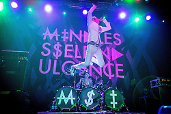 © Licensed to London News Pictures . 04/12/2013 . Manchester , UK . Jimmy Urine ( James Euringer ) jumps from the drums on to the stage as Kitty ( Jennifer Dunn ) plays drums . Mindless Self Indulgence ( MSI ) play the Ritz in Manchester . Photo credit : Joel Goodman/LNP