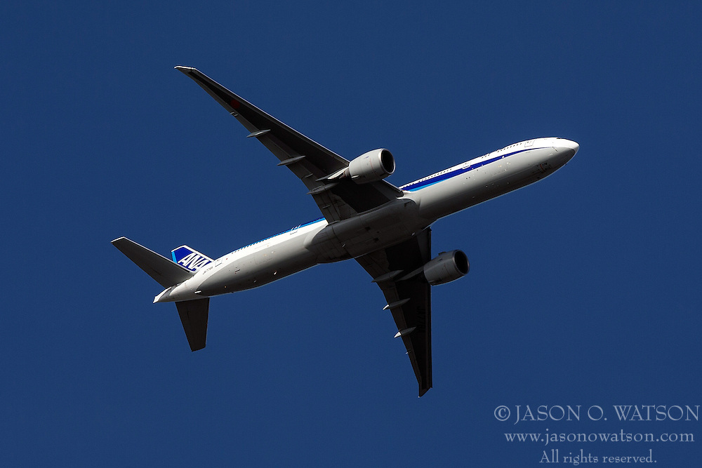 Boeing 777 Air Nippon Airways (registration J778A) flies over Palo Alto Airport (KPAO), Palo Alto, California, United States of America