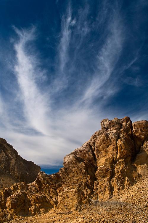 Cloud & Eroded hillside, Twenty Mule Team Canyon, Death Valley National Park, California