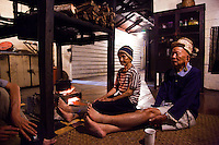 Sitting around the fireplace with an elderly Kelabit couple at a Bario Longhouse in Sarawak.