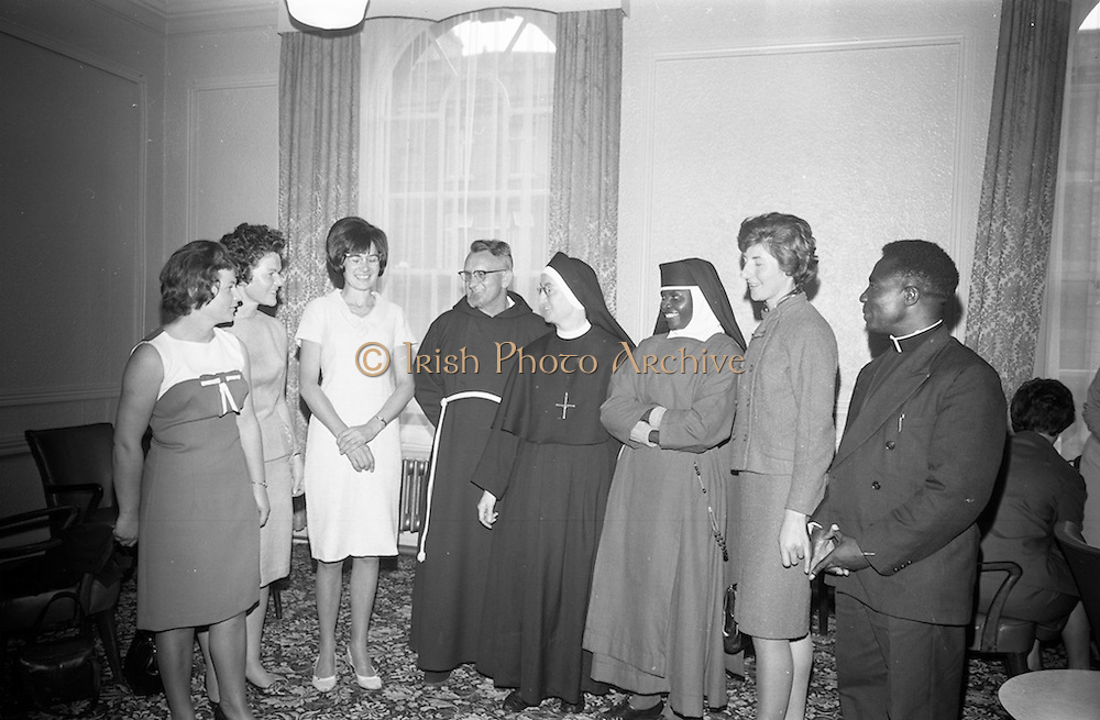 20/08/1966<br /> 08/20/1966<br /> 20 August 1966<br /> Irish Zambian Missionaries reunion at Wynn's Hotel Dublin. Group of Irish teachers, nurses, priests and sisters all of whom were connected with the Capuchin and Holy Cross Mission in Zambia and Rhodesia met at an informal luncheon. Picture shows: Sr. M. Lelia, (5th from left) of Holy Cross Convent, Glen Road, Belfast, who organised the gathering after returning to Ireland after 34 years in Africa, chatting with (l-r) Miss Kathleen Curtin, Abbeyfeale, Co. Limerick; Miss Celia Curtin, Abbeyfeale; Miss Aedamar Aiken, Dublin (daughter of Frank Aiken); very Rev. Fr. Alfred, O.F.M. Capuchin, Superior Regular of the Capuchin Missions in Zambia; Sr. Lelia; Sr. Terese, Little Sisters of St. Francis, Livingstone, Zambia; Miss Olive Quinlan, Cashel and Rev. Fr. John Lupambo, Assistant Diocesan Chaplin for Lay Apostolate, Fort Rosberry Diocese, Zambia.