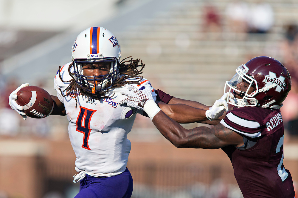 STARKVILLE, MS - SEPTEMBER 19:  Daniel Taylor #4 of the Northwestern State Demons stiff arms Will Redmond #2 of the Mississippi State Bulldogs at Davis Wade Stadium on September 19, 2015 in Starkville, Mississippi.  The Bulldogs defeated the Demons 62-13.  (Photo by Wesley Hitt/Getty Images) *** Local Caption *** Will Redmond; Daniel Taylor