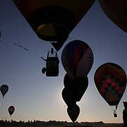 A Hot Air balloonist drops a marker at a goal location around rural Michigan near Battle Creek during the World Hot Air Ballooning Championships. Battle Creek, Michigan, USA. 21st August 2012. Photo Tim Clayton