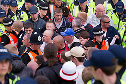 © Licensed to London News Pictures. 02/06/2012. Brighton, UK.Police surround supporters of the EDL and other nationalist groups in Brighton. Photo credit : Joel Goodman/LNP