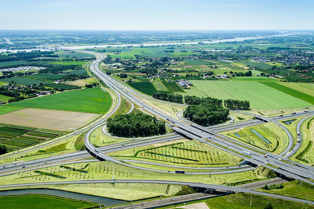 Nederland, Gelderland, Gemeente Overbetuwe, 09-06-2016; knooppunt Valburg, kruising A50 met A15 gezien naar rivier de Waal. Betuweroute in de voorgrond.<br /> Valburg junction, A50 and A15, Betuweroute.<br /> <br /> luchtfoto (toeslag op standard tarieven);<br /> aerial photo (additional fee required);<br /> copyright foto/photo Siebe Swart