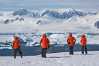 Guests enjoying a view across Lallemand Fjord from  Detaille Island in Graham Land, Antarctica.