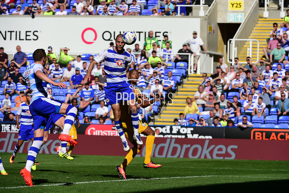 Reading defender Joey Van Den Berg (4) heads down the ball from Preston North End forward Jermaine Beckford (10) during the EFL Sky Bet Championship match between Reading and Preston North End at the Madejski Stadium, Reading, England on 6 August 2016. Photo by Jon Bromley.
