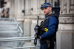 © Licensed to London News Pictures. 28/03/2017. London, UK. An armed policeman stands at the entrance to Parliament. Security around London has been increased following Khalid Masood's terrorist attack and the killing of PC Keith Palmer on 22 March. Photo credit : Tom Nicholson/LNP