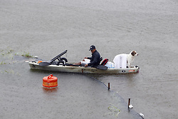 (170827) -- HOUSTON, Aug. 27, 2017 (Xinhua) -- A man and his dog stay on a boat as the area is completely flooded in great Huston area, Texas, the United States, Aug. 27, 2017. Widespread and worsening flood conditions prompted the closure of nearly every major road in Houston as the outer bands of Hurricane Harvey swept through the Houston area over the weekend. Latest news reports said the storm death toll has climbed to at least 5. (Xinhua/Song Qiong) (Photo by Xinhua/Sipa USA)