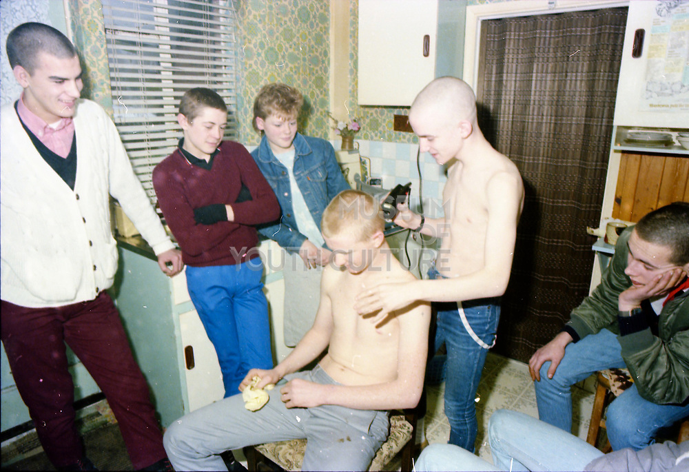 Hawkins having his head shaved at Hawthorne Road, High Wycombe, UK, 1980s