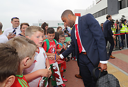 CARDIFF, WALES - Saturday, June 4, 2016: Wales' captain Ashley Williams and his team sign autographs for Ysgoal Treganna students as the team are given a colourful send off at Cardiff Airport as the squad head to Sweden for their last friendly before the UEFA Euro 2016 in France. (Pic by David Rawcliffe/Propaganda)