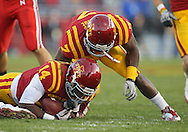 November 06 2010: Iowa State Cyclones cornerback Deon Broomfield (14) pulls in a lose ball as Iowa State Cyclones linebacker Jeremiah George (7) watches during the second half of the NCAA football game between the Nebraska Cornhuskers and the Iowa State Cyclones at Jack Trice Stadium in Ames, Iowa on Saturday November 6, 2010. Nebraska defeated Iowa State 31-30.