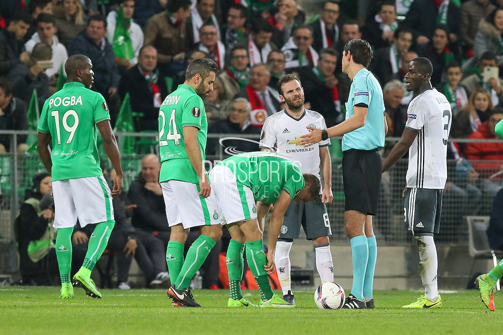 Juan Mata Midfielder of Manchester United argues with Referee Deniz Aytekin after showing red card to Eric Bailly Defender of Manchester United during the Europa League match between Saint-Etienne and Manchester United at Stade Geoffroy Guichard, Saint-Etienne, France on 22 February 2017. Photo by Phil Duncan.
