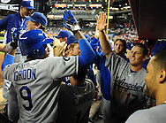 Sep. 27 2011; Phoenix, AZ, USA; Los Angeles Dodgers infielder Dee Gordon (3) is congratulated by teammate catcher A.J. Ellis (17) after scoring during the tenth inning against the Arizona Diamondbacks at Chase Field.  Mandatory Credit: Jennifer Stewart-US PRESSWIRE.