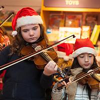 """Aioife O'Gorman playing violin as part of """"Santa Tales"""" at the Ennis Bookshop"""