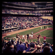 An Instagram of fans celebrating as Joe Mauer of the Minnesota Twins slides into home scoring the winning run at Target Field in Minneapolis, Minnesota.