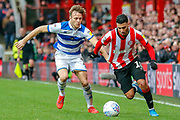 Queens Park Rangers defender Todd Kane (2) battles for possession with Brentford forward Saïd Benrahma (10) during the EFL Sky Bet Championship match between Brentford and Queens Park Rangers at Griffin Park, London, England on 11 January 2020.